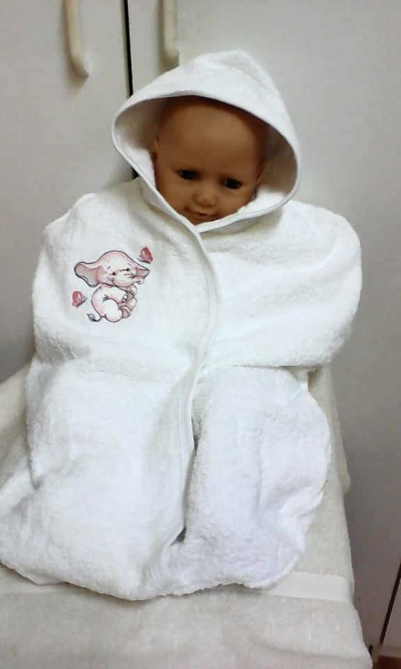 Embroidered bathrobe with dancing elephant design