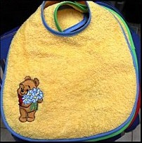 Winnie the Pooh with bouquet of chamomiles embroidered on baby bib