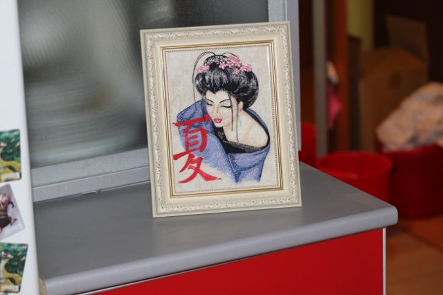 Geisha with hieroglyphic design embroidered frame
