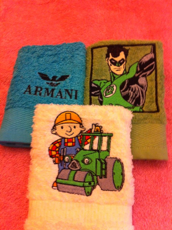 Bath towels embroidered with Bob the Builder and Green Lantern designs