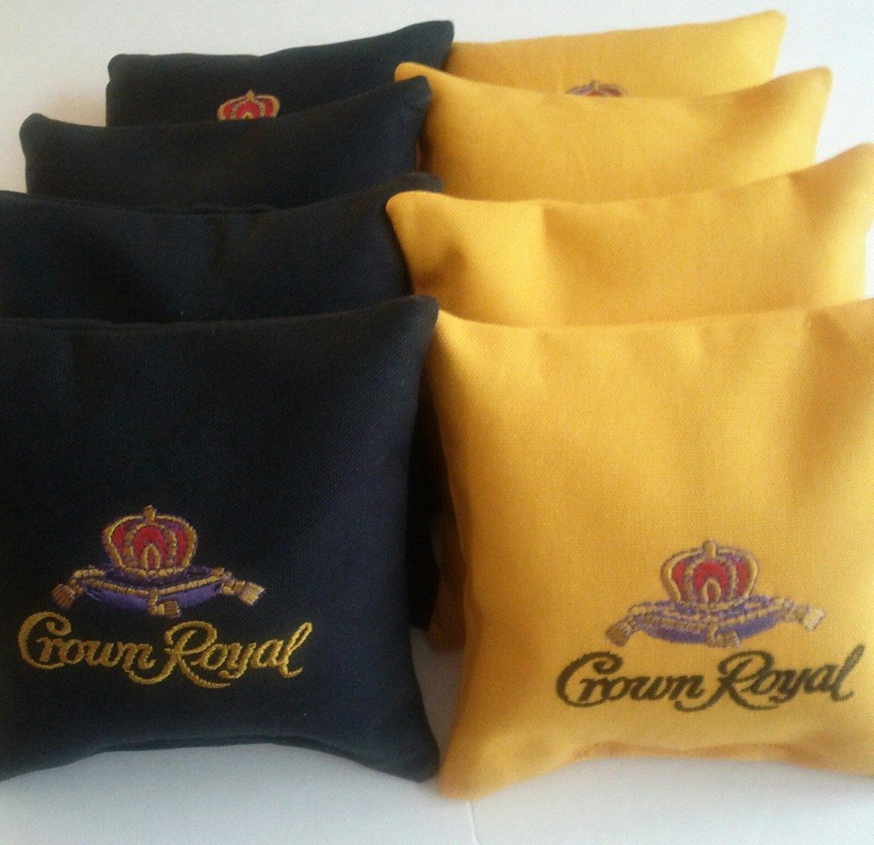 Embroidered yellow and black pillowcases with Crown Royal Maple logo