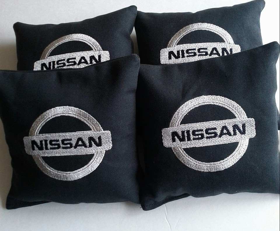 Black embroidered pillowcases with Nissan logo