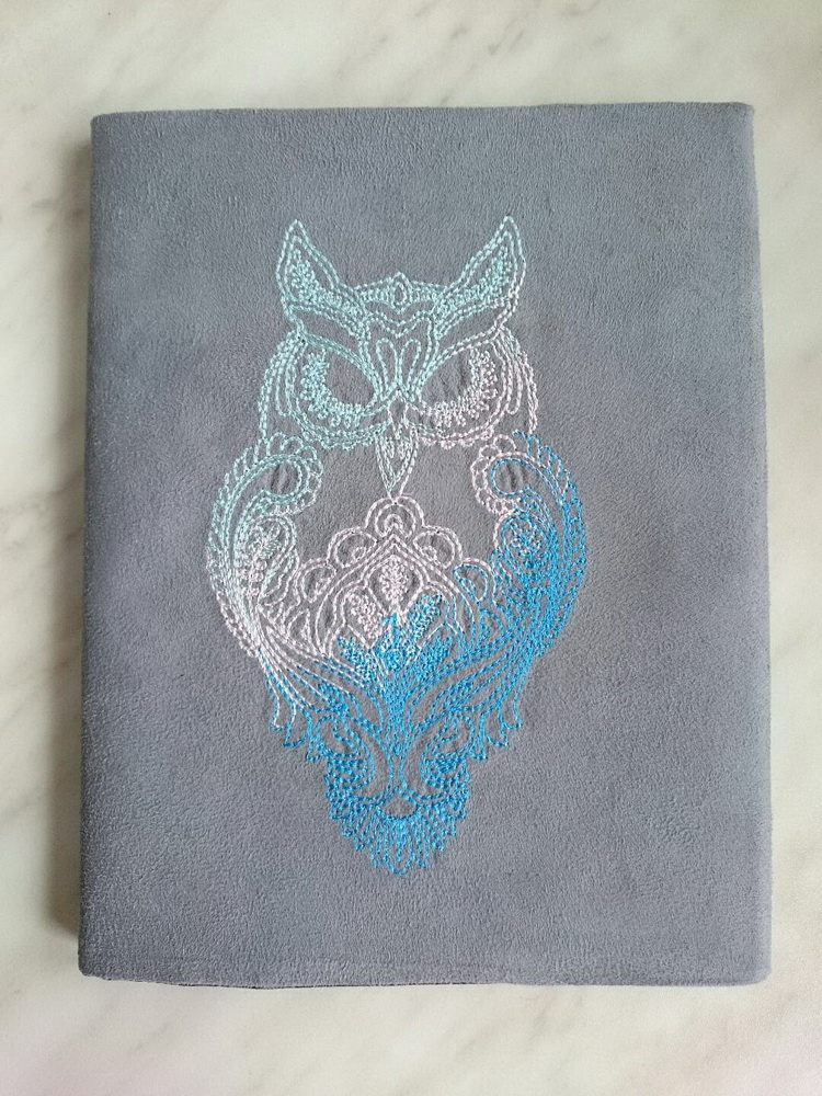 Cute embroidered cover with owl on it