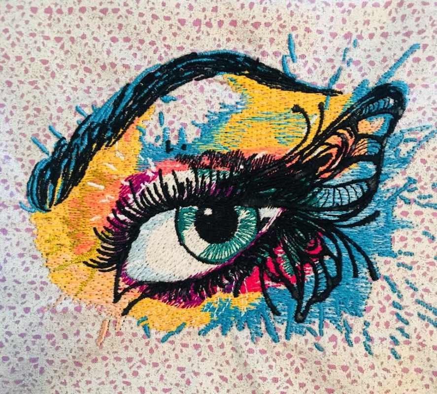 Embroidered winged eye design