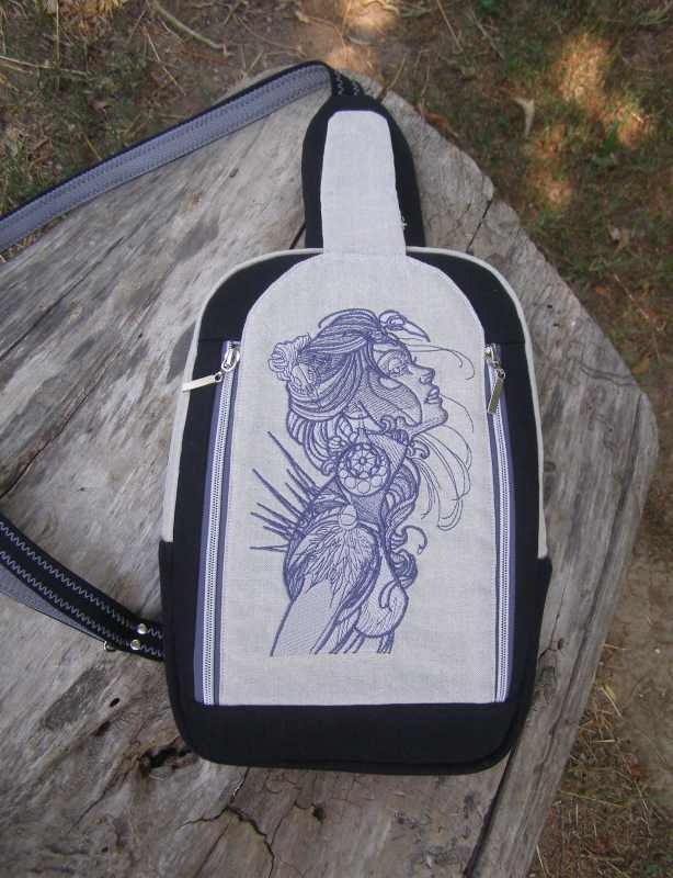 Denim backpack with sexy woman embroidery design