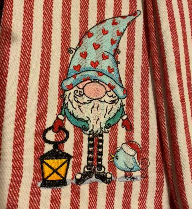 Embroidered Christmas dwarf with lantern and bird