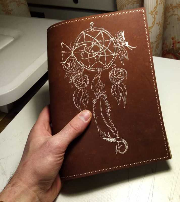 Embroidered leather diary cover with dreamcatcher design