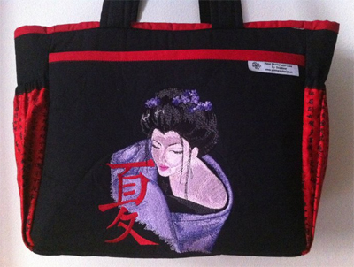 Geisha with hieroglyphic embroidery design on bag