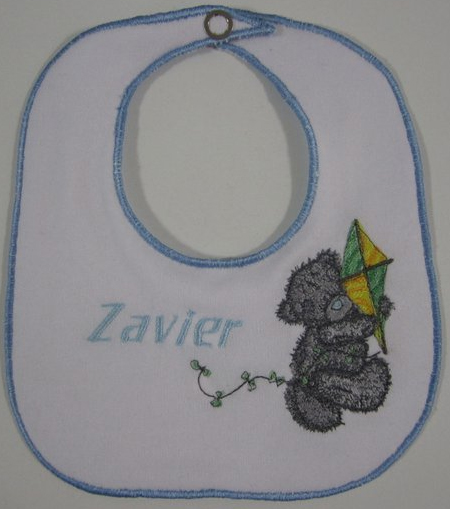 Teddy bear with kite design embroidered on bib