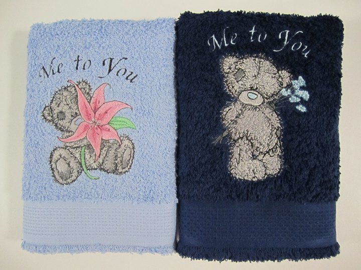 Blue nose bears on embroidered towels