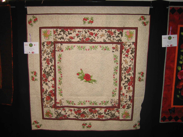 Embroidered quilt with flowers