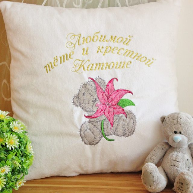 Tatty teddy with lily flower embroidered on pillowcase