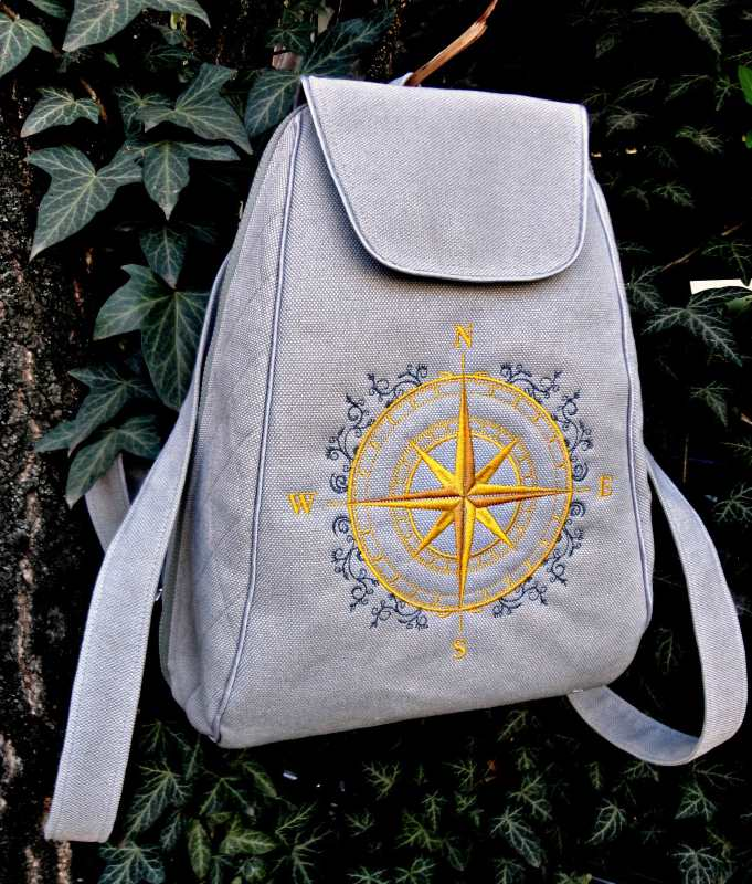 Embroidered backpack with rose of wind free embroidery