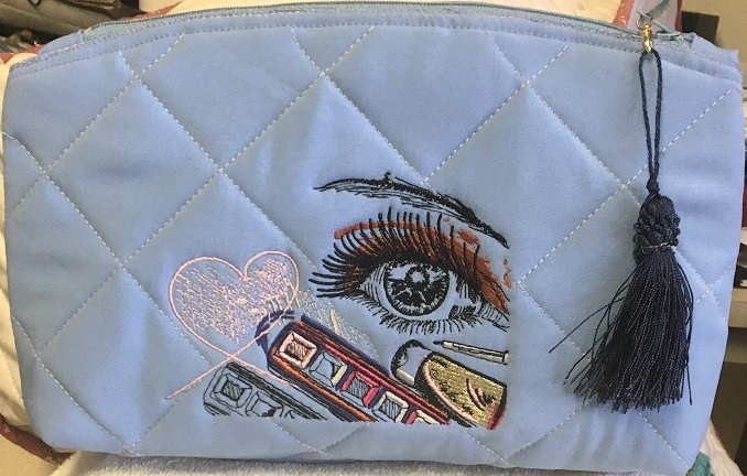 Beauty bag with fashion look embroidery design