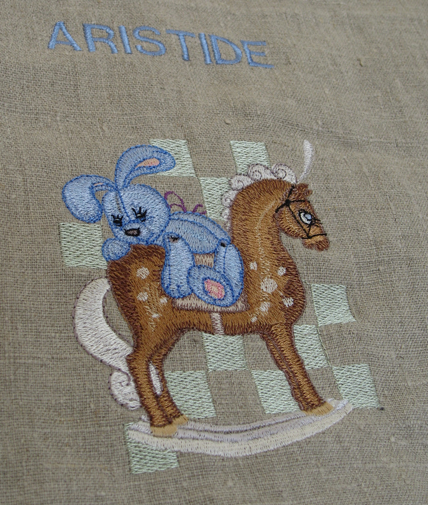 Bunny riding horse machine embroidery design