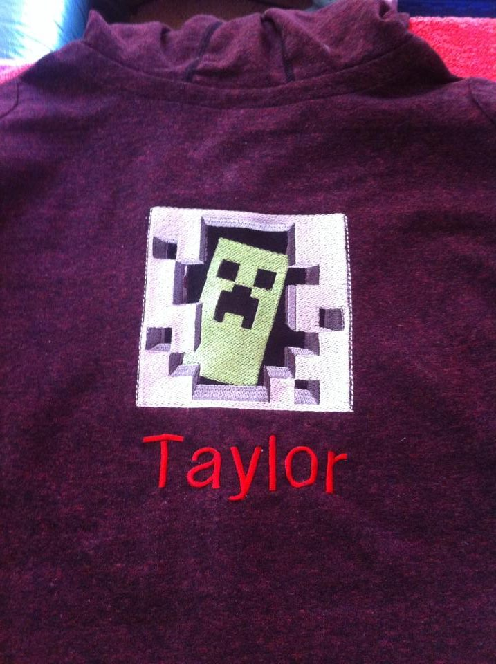 Embroidered Creeper on purple hoodie
