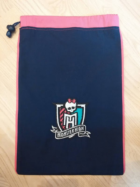 Black and pink textile bag with embroidered logo