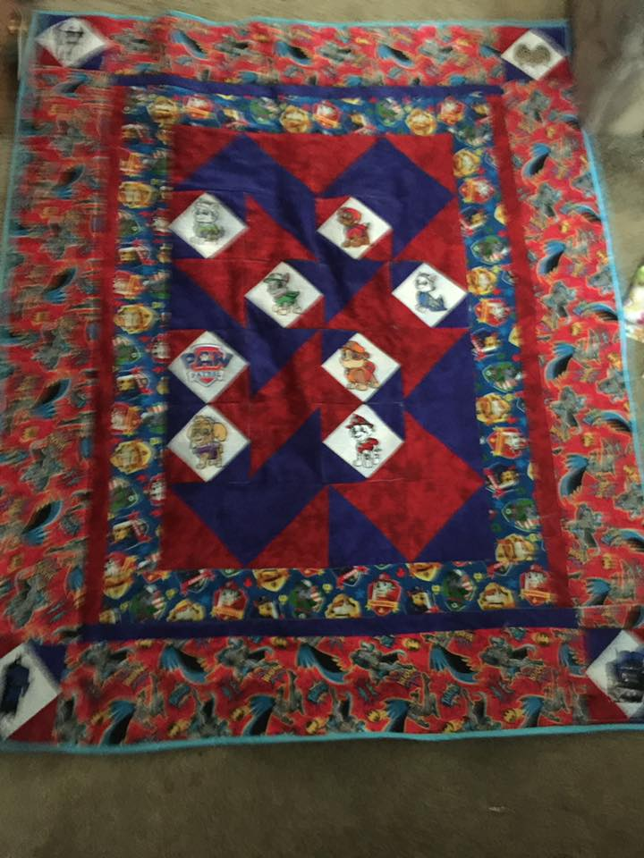 Baby quilt embroidered with Paw Patrol dog designs