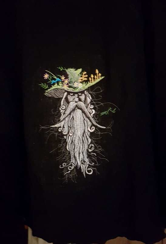 Embroidered root man design