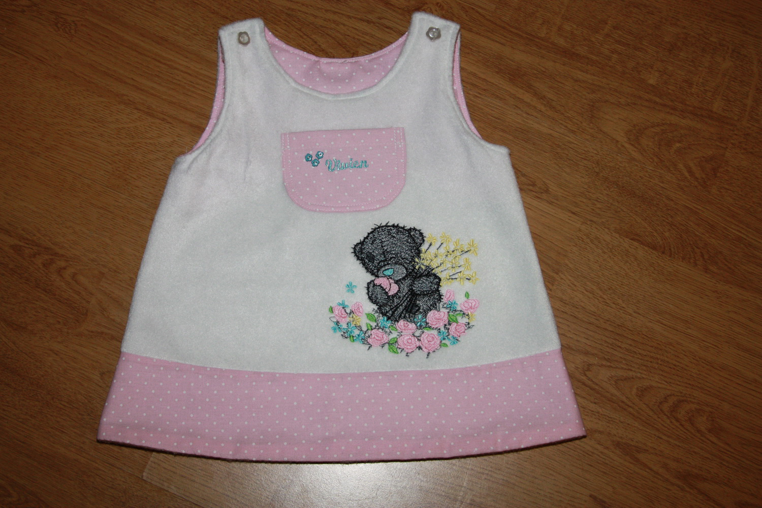 Teddy bear and the sea of flowers design on embroidered white dress