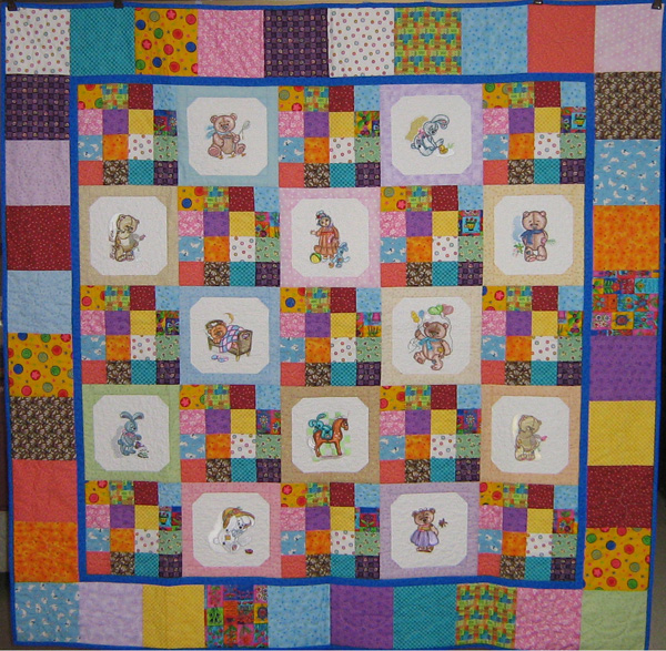 Old toys designs embroidered on quilt