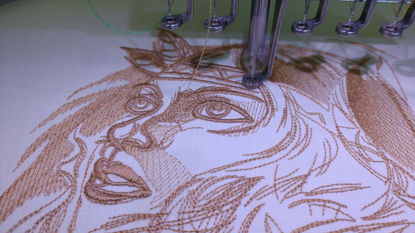 Indian woman machine embroidery