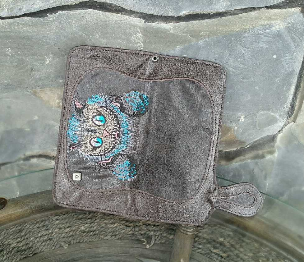 Small leather bag with Cheshire cat design