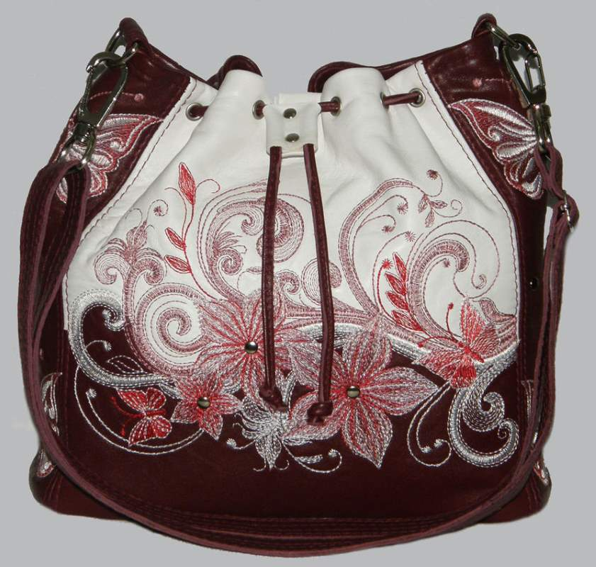Leather handbag with flowers pattern