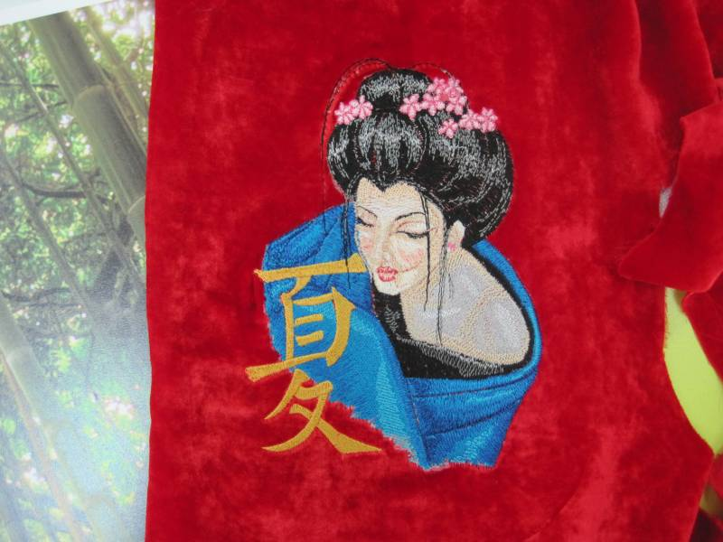 Geisha with hieroglyphic embroidery design on clothes