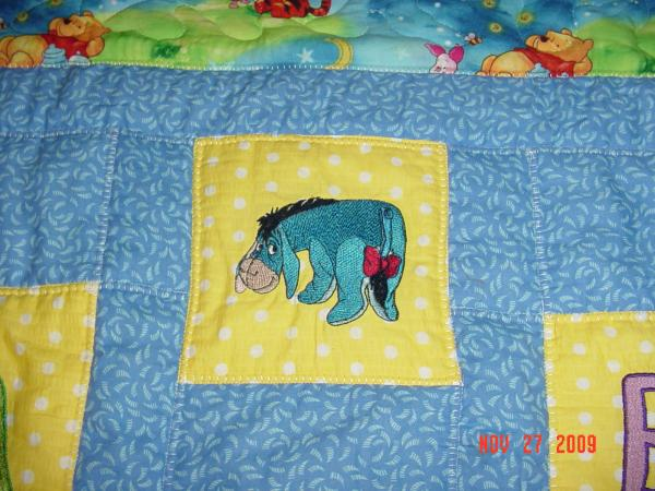 Embroidered sad Eeyore on baby quilt