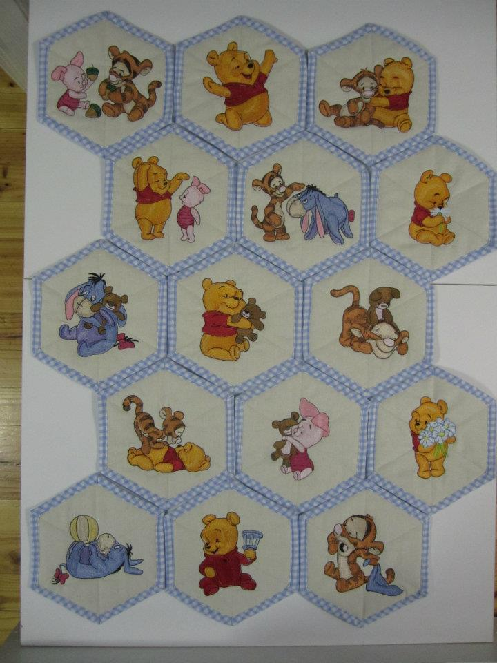 Baby Pooh designs on quilt embroidered