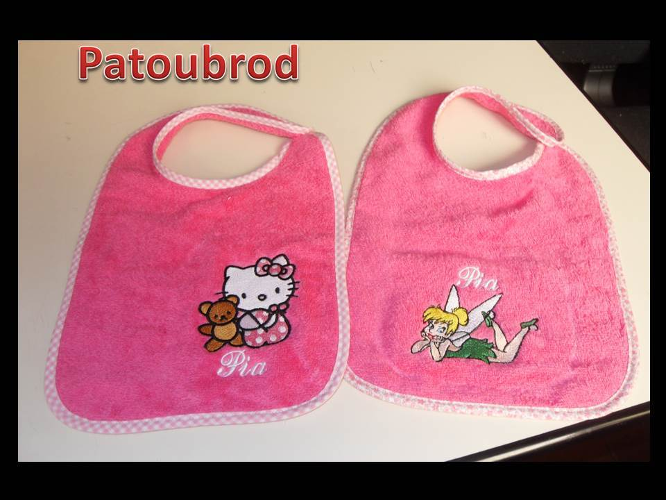 Pink embroidered bibs with Tinkerbell and Hello Kitty