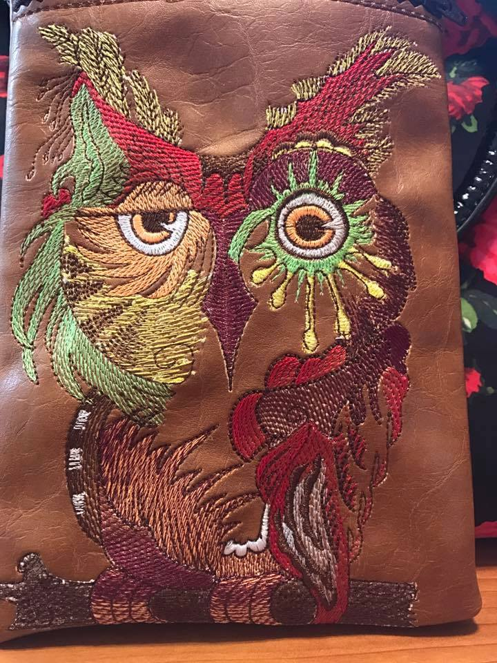 Brown leather bag with embroidered owl