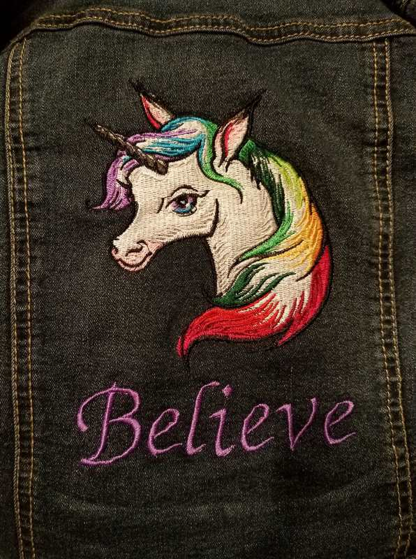 Denim pocket with rainbow unicorn embroidery design