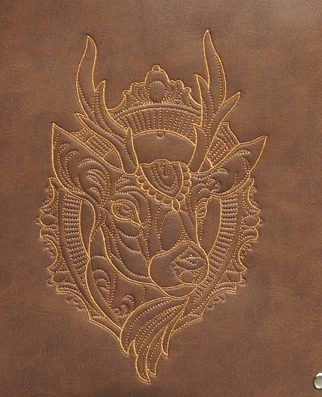 Embroidered leather with deer head design