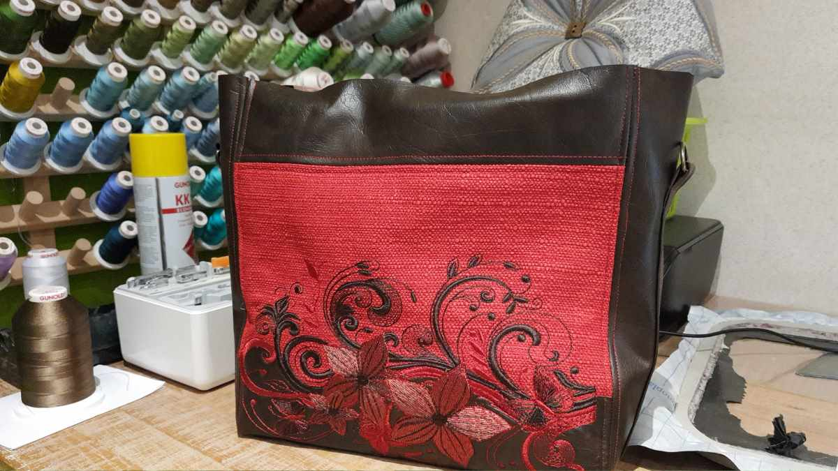 Finishing embroidered women bag with bouquet design