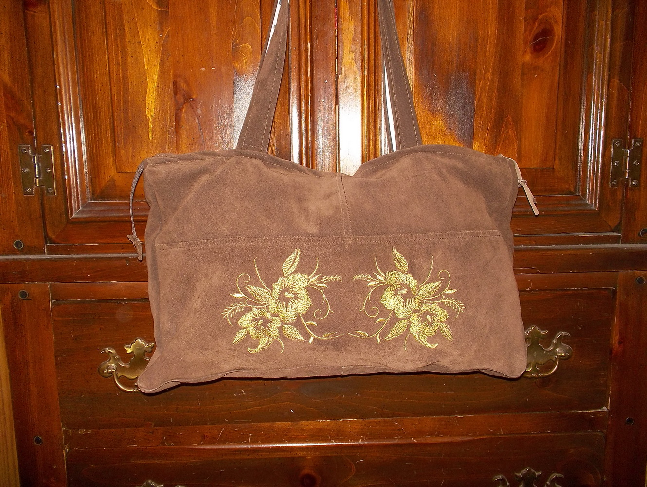 Brown embroidered bag with blue flower design