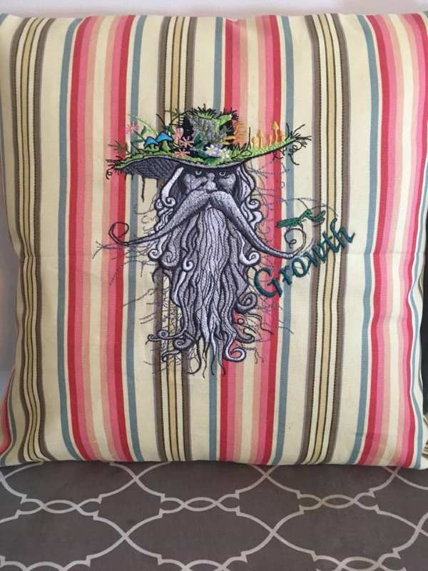 Pillow with mystic man embroidery design