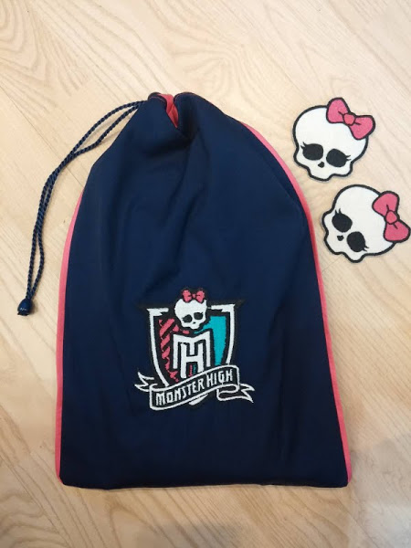 Monster High designs embroidered on bag