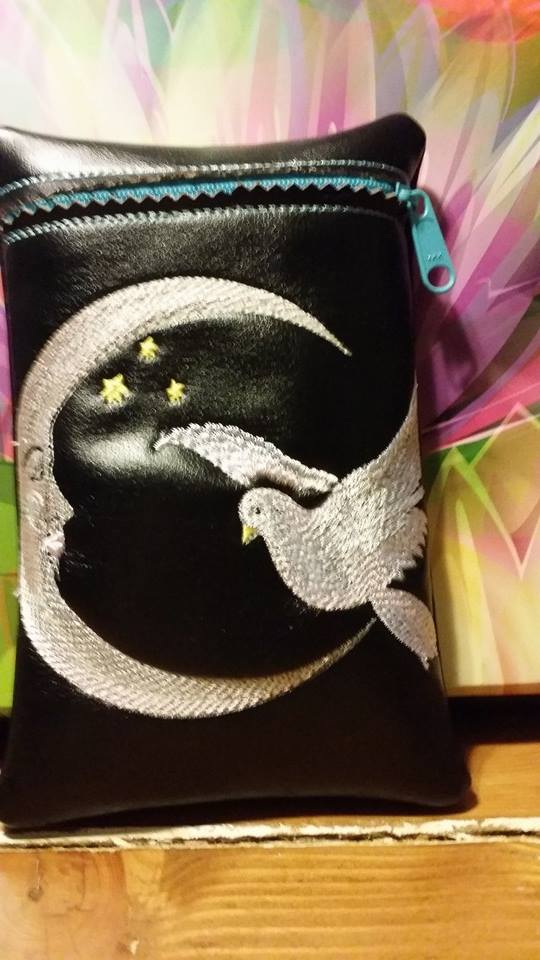 Crescent and dove design on bag1