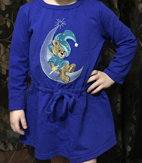 Embroidered sweater with teddy wizard design