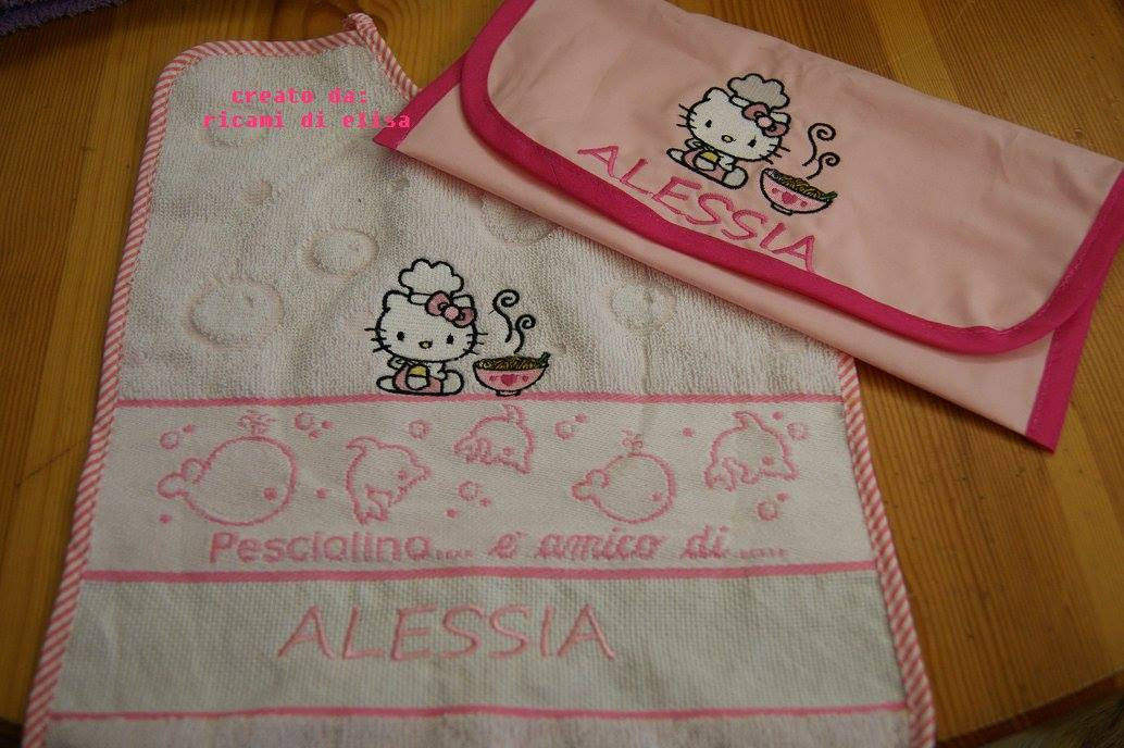 Bath towel embroidered with Hello kitty design