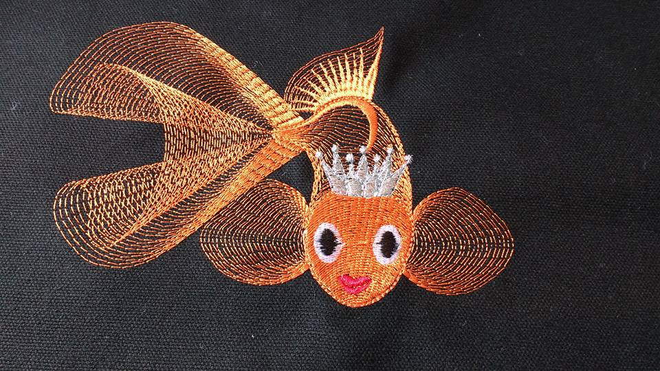 Black pillowcase with embroidered Gold fish on it