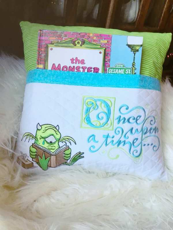 Embroidered cushion with monster design