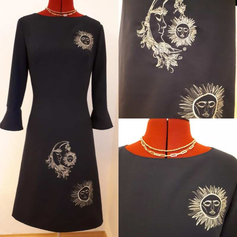 Woman dress with sun and moon embroidery design