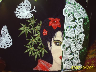 Geisha with flower embroidered on black bag