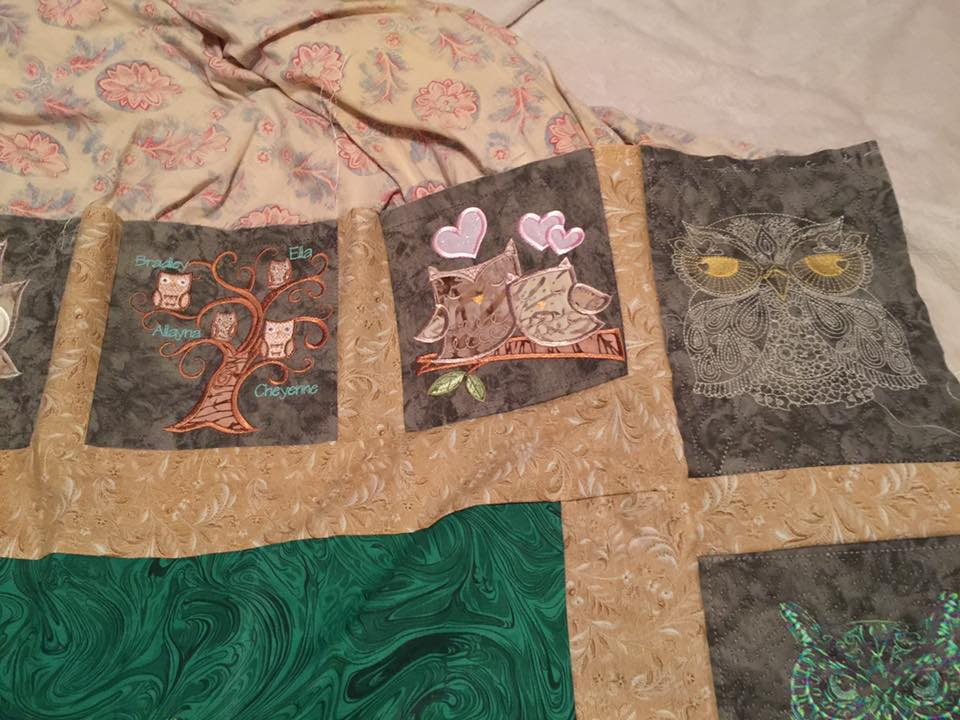 Different owls embroidered on cute quilt