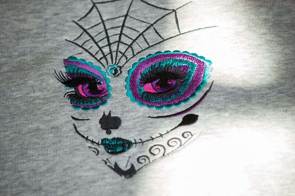 Woman skull embroidered design