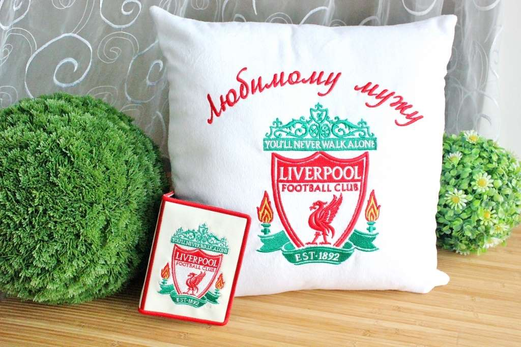 Embroidered cushion and doc cover with logo