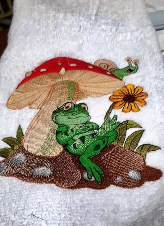 Resting frog embroidered at bath towel